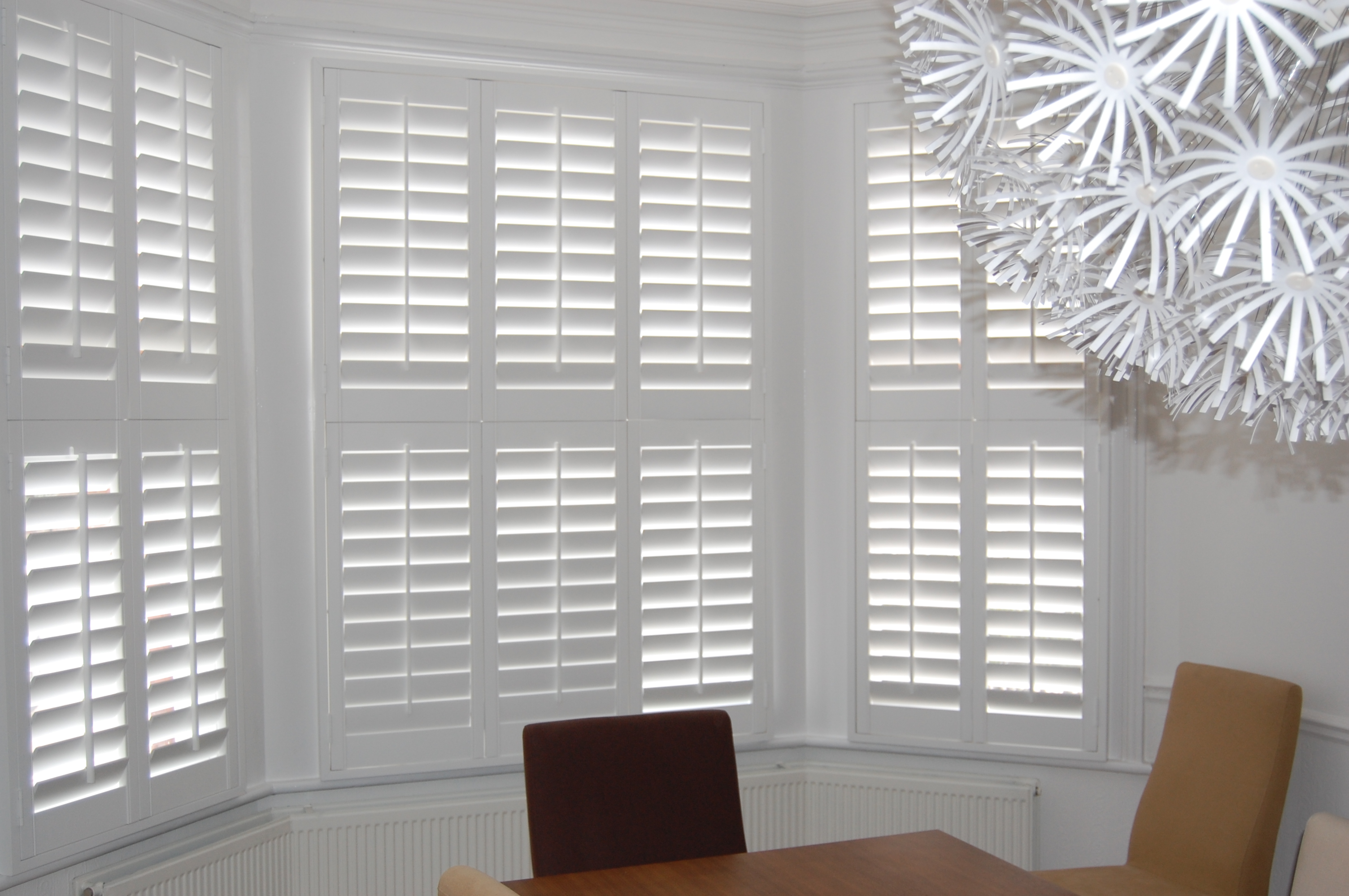 Plantation shutters internal blinds at penumbra kent for Should plantation shutters match trim